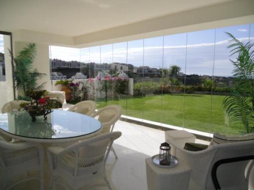 terrace with glass curtains
